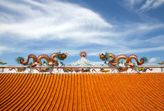Twin dragons on the roof. Statue of twin dragons on the roof of Chinese temple Royalty Free Stock Image