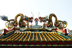 Twin dragons on the roof of Chinese temple. Statue of twin dragons on the roof of Chinese temple Stock Photo