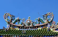 Twin dragons statue on Chinese temple roof Stock Photos