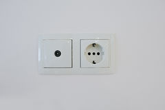 Twin electric socket with tv plug at the wall Royalty Free Stock Images
