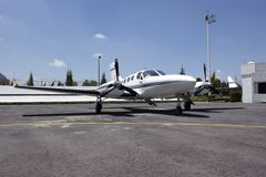 Twin engine aircraft. Twin engine propeller aircraft in FBO Stock Image