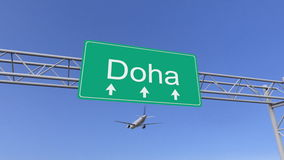 Twin engine commercial airplane arriving to Doha airport. Travelling to Qatar conceptual 3D rendering Stock Photos
