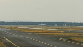 Approaching of jet airliner. Twin engine jet airliner approaching to airport stock footage