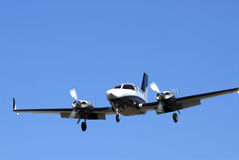Twin Engine Plane. Private twin engine plane on landing approach Royalty Free Stock Photography