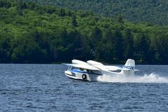 Twin engine seaplane taking off Royalty Free Stock Image