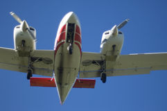 Twin engined commuter plane in flight Stock Photography