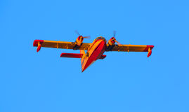 A twin-engined water bomber stock image