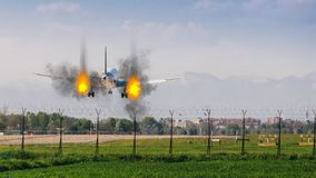 Twin engines on fire emergency landing concept at airport stock image
