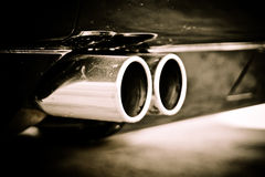Twin exit tail pipe. Close up detail of a twin exit tail pipe Royalty Free Stock Photography