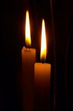 Twin Flames. Glowing candles in the darkness Royalty Free Stock Image