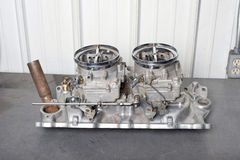 Twin four barrel carburetor. A classic twin four barrel carburetor for a classic Ford pickup Royalty Free Stock Photos