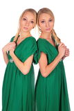 Twin girls back-to-back 2 Royalty Free Stock Photo