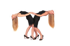 Twin girls bend behind Royalty Free Stock Photos