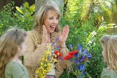 Twin girls & grandma flowers stock photo