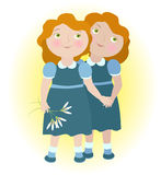 Twin girls holding hands Royalty Free Stock Images
