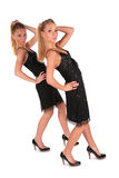Twin girls. Incline behind hand up. Stock Photography