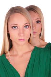 Twin girls. Look from behind Stock Images
