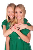 Twin girls one behind Royalty Free Stock Photo