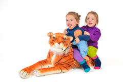 Twin Girls riding a Tiger Royalty Free Stock Photo
