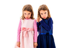 Twin girls are sad, lonely and moody. Royalty Free Stock Photography