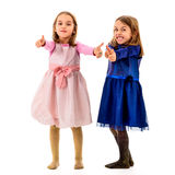 Twin girls are showing thumbs up sign or gesture. Royalty Free Stock Photo