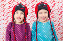 Twin girls are smiling at the camera and being happy. Little chi Stock Photography