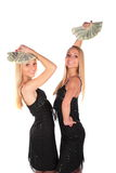 Twin girls sway Dollars Royalty Free Stock Images