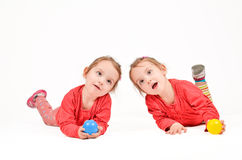 Twin Girls on white Background Stock Images