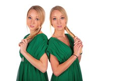 Twin girs back-to-back. On white Royalty Free Stock Photos