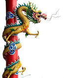 Twin Golden Chinese Dragon Wrapped around red pole on isolate background. Royalty Free Stock Photo