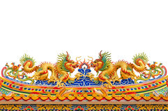 Twin golden dragon statues in Chinese style. On top of general temple roof Royalty Free Stock Images