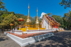 Twin golden pagoda in front of Buddhist church at Wat Phra Thart Stock Photo