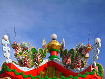 Twin green china dragon on the roof of octagon pavilion Stock Images