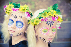 Twin halloween girls with closed eyes Stock Photos