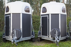Twin horse trailers. Two horse trailers parked in the forest Stock Photos