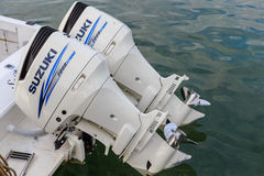 Twin 300 HP Suzuki Four Stroke Outboard Motors. Twin 300 horsepower Suzuki outboard motors with stainless steel propellers Royalty Free Stock Photography