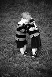 Twin hug. Twin baby boys hugging in rugby clothing stock photography