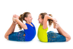 Twin kid sisters symmetrical flexible playing happy Stock Image