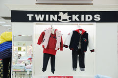Twin kids   baby clothes shop Stock Image