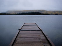 Twin Lakes boating dock fall rain Yukon Canada Stock Images