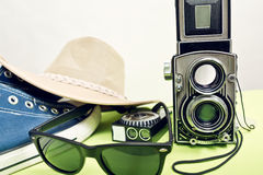 Twin-lens reflex camera with sneaker Royalty Free Stock Image