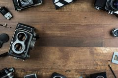 Vintage camera with dual lens system. Twin lens reflex vintage camera on a wooden background Stock Images