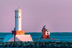 The twin lighthouses of Mackinac Island at sunset on Lake Michigan. The twin lighthouses of Mackinac Island at sunset stock images