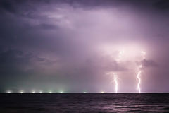 Twin Lightning Bolts on the sea Royalty Free Stock Photography