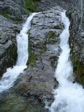 Twin-like waterfall in nothern Mountains. Twin-like waterfall in Mountains in the north at midday in sumer stock photography