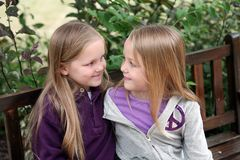 Twin little girls hugging Stock Photos