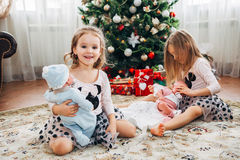 Twin little girls with presents stock photos