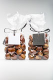 Twin luxury plastic bags of fresh chestnuts with blank labels Royalty Free Stock Photo