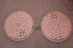 Twin Manhole cover on ground Stock Image