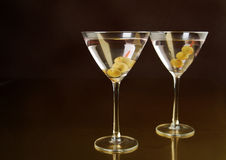 Twin martinis. Two martinis on a dark background, focus on rim of front glass Royalty Free Stock Photo